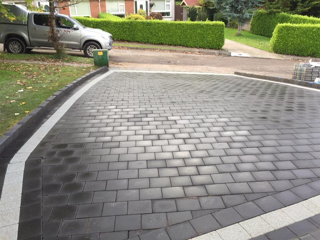 Paving Driveway and on Landscaping